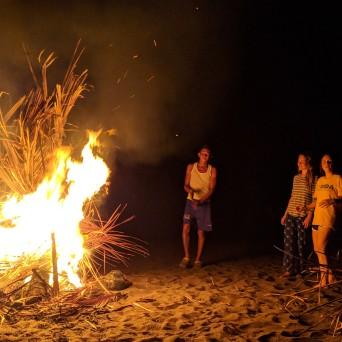 Some guests enjoying an evening bonfire